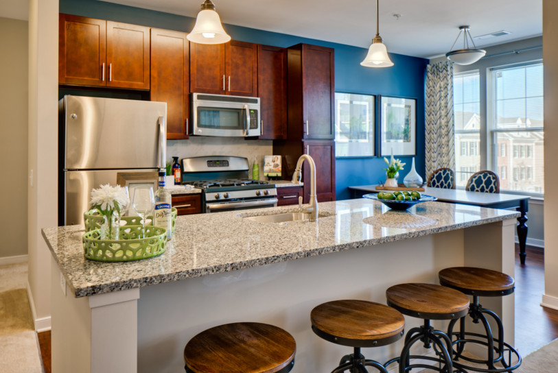 Gourmet kitchens include gas ranges, granite countertops, kitchen islands, Shaker cabinets, backsplash tiles and GE ENERGY STAR stainless steel appliances.