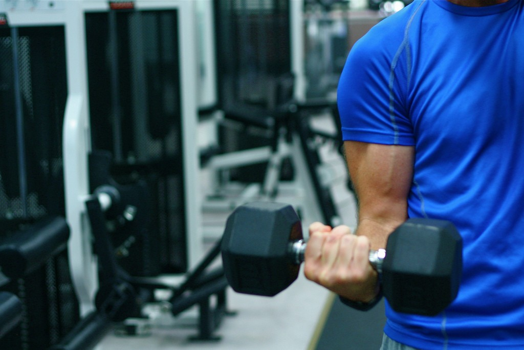 Man's arm lifting weight
